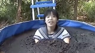Extreme Japscat girl jumping into manure pool xxx porn video